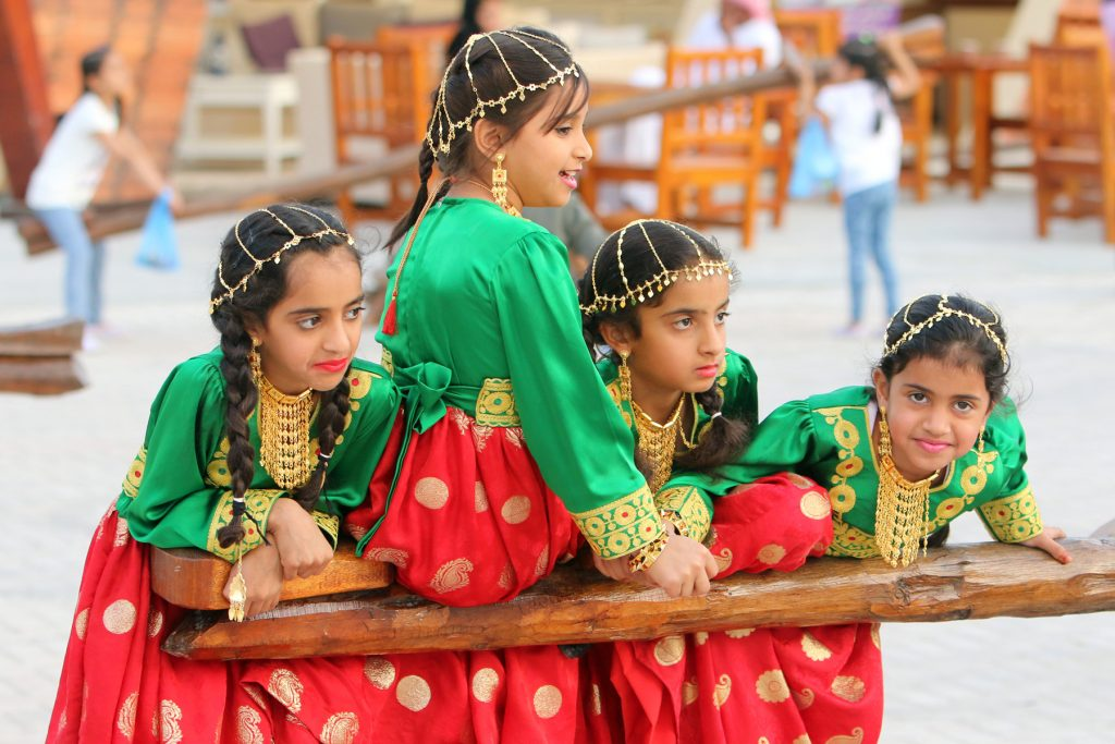 NA040515-MS-HERITAGE DAYS – girls wearing traditions dresses having fun time at traditional swings during the Sharjah heritage days in Sharjah on Monday – KT photo by M.Sajjad